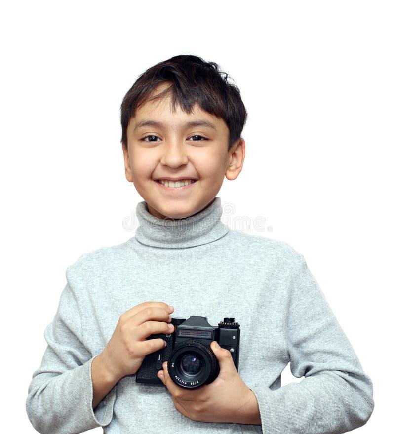Glimlachende jongen met camera stock afbeelding