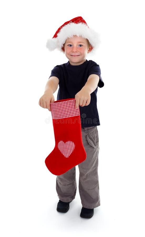 Glimlachende Kerstmiskous van de jongensholding royalty-vrije stock foto's