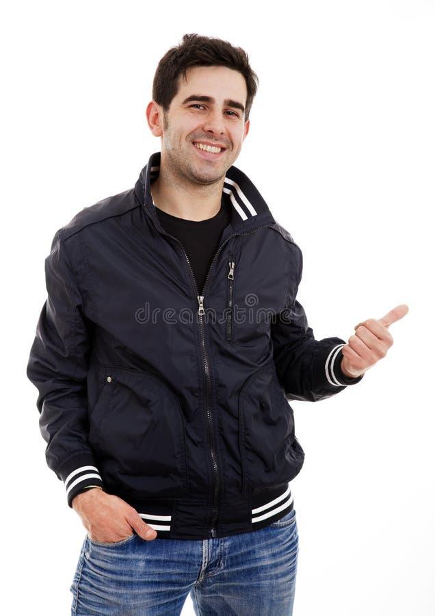 Glimlachende knappe jonge mens stock foto