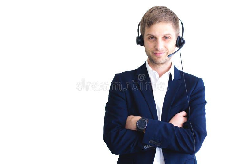 Glimlachende knappe klantenondersteuningsexploitant met hoofdtelefoon royalty-vrije stock afbeeldingen