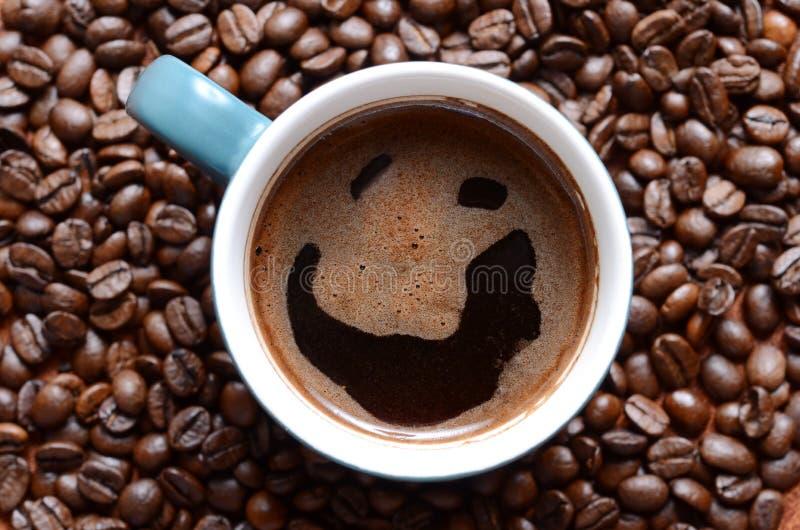 Glimlachende koffie stock foto