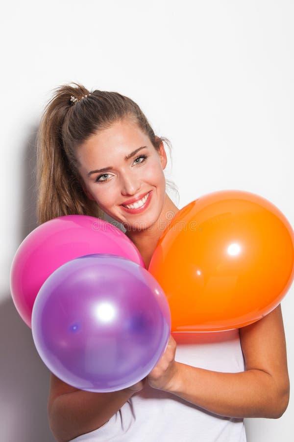 Glimlachende meisje en ballons royalty-vrije stock foto