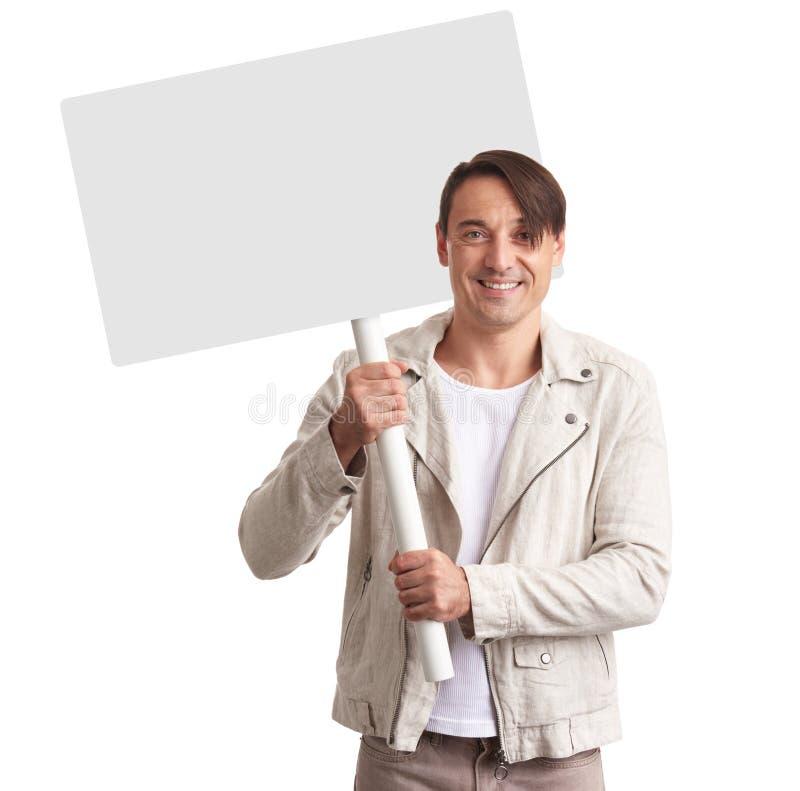 Glimlachende mens die leeg aanplakbiljet tonen stock afbeeldingen