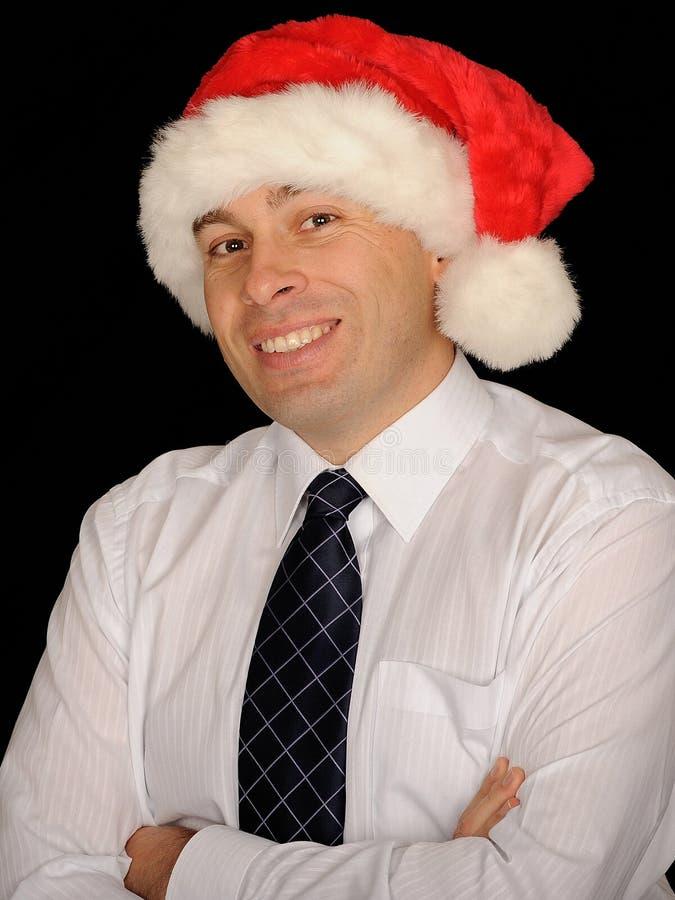 Glimlachende mens met de hoed van de Kerstman royalty-vrije stock foto