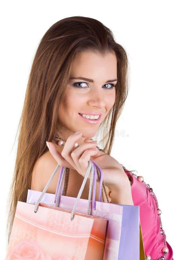 Glimlachende mooie vrouw met document het winkelen zakken stock afbeelding