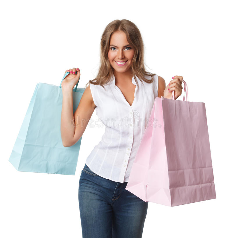 Glimlachende mooie vrouw met document zakken stock afbeelding