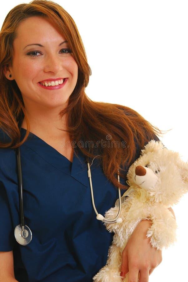 Glimlachende pediatrische verpleegster royalty-vrije stock afbeelding