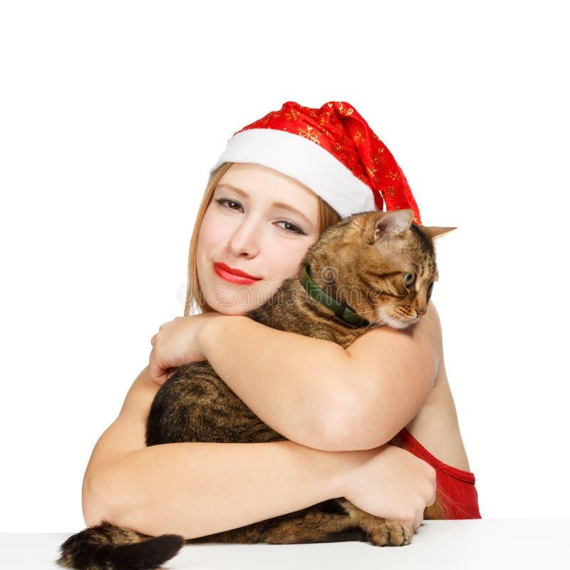 Glimlachende santavrouw met gestreepte katkat stock fotografie