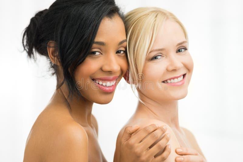 Glimlachende schoonheidsvrouwen stock foto