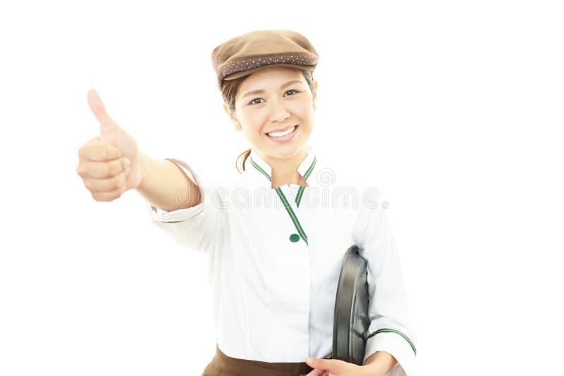 Glimlachende serveerster stock fotografie