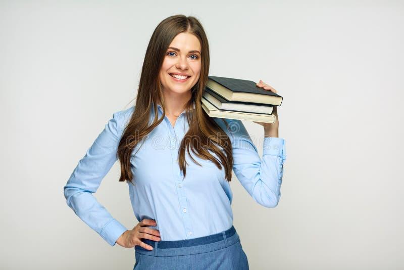 Glimlachende studente, leraars of bedrijfsdameholdingsboeken royalty-vrije stock foto
