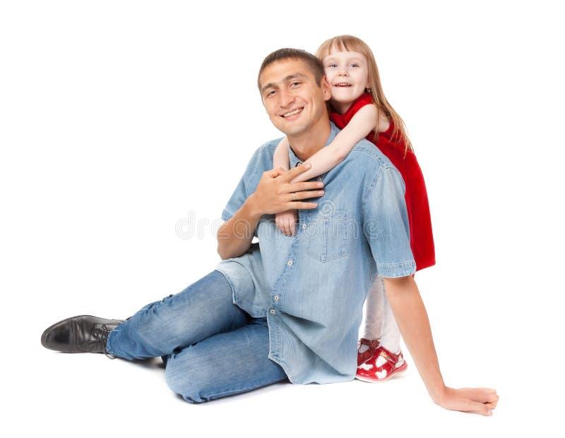Glimlachende vader en jonge dochter stock foto's