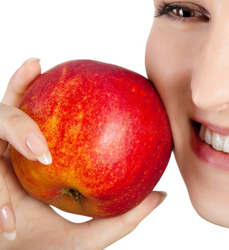 Glimlachende vrouw met appel royalty-vrije stock foto's