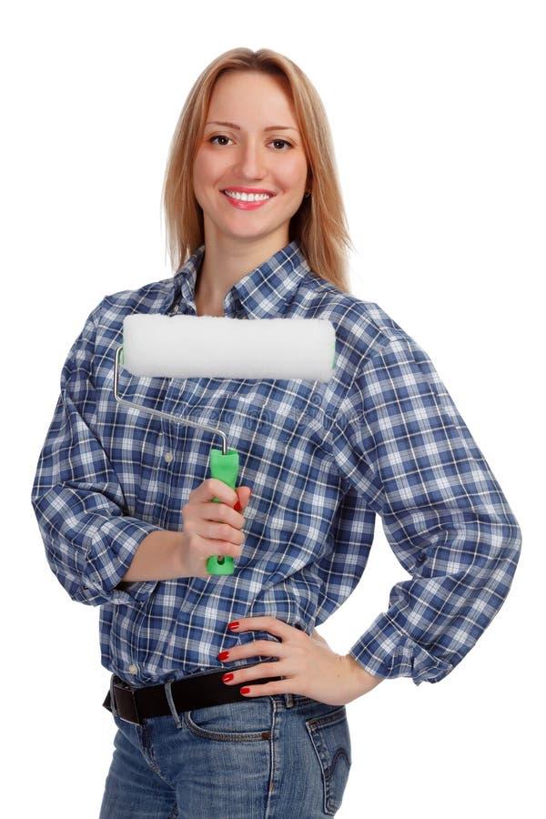 Glimlachende vrouw met een borstel stock afbeelding