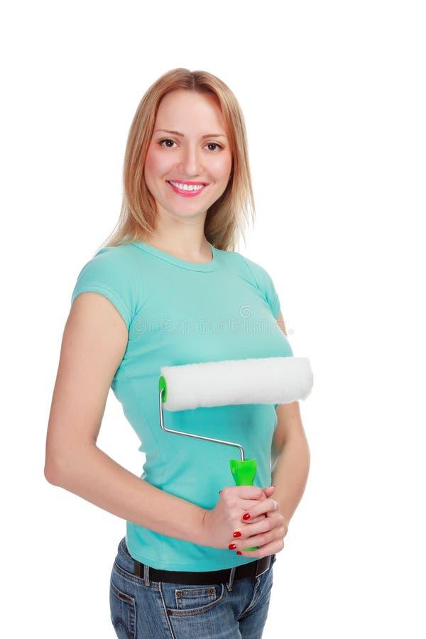Glimlachende vrouw met een borstel stock foto