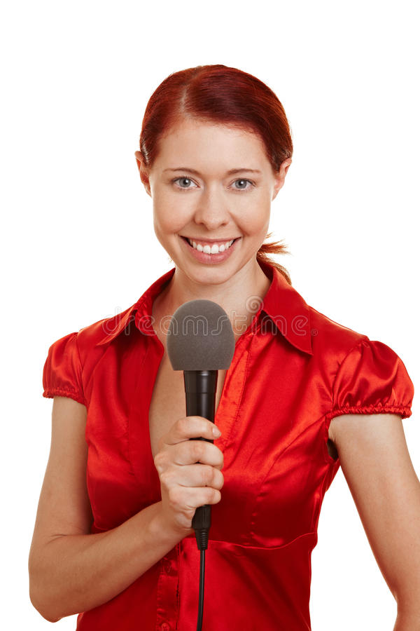 Glimlachende vrouw met microfoon stock afbeeldingen