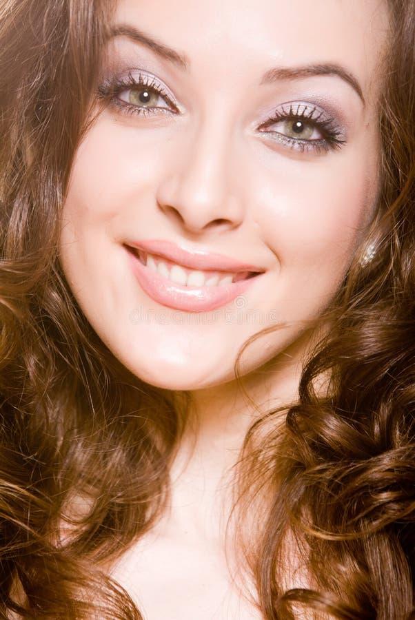 Glimlachende vrouw met professionele ma stock fotografie