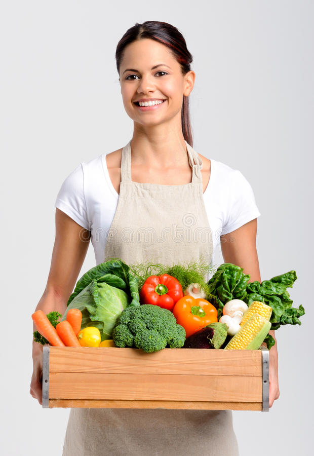 Glimlachende vrouw met vers product stock afbeeldingen