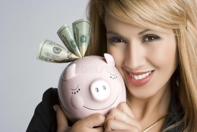 Glimlachende Vrouw Piggybank royalty-vrije stock afbeelding