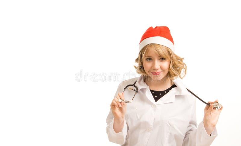 Glimlachende vrouwelijke arts met GLB van de Kerstman stock foto's