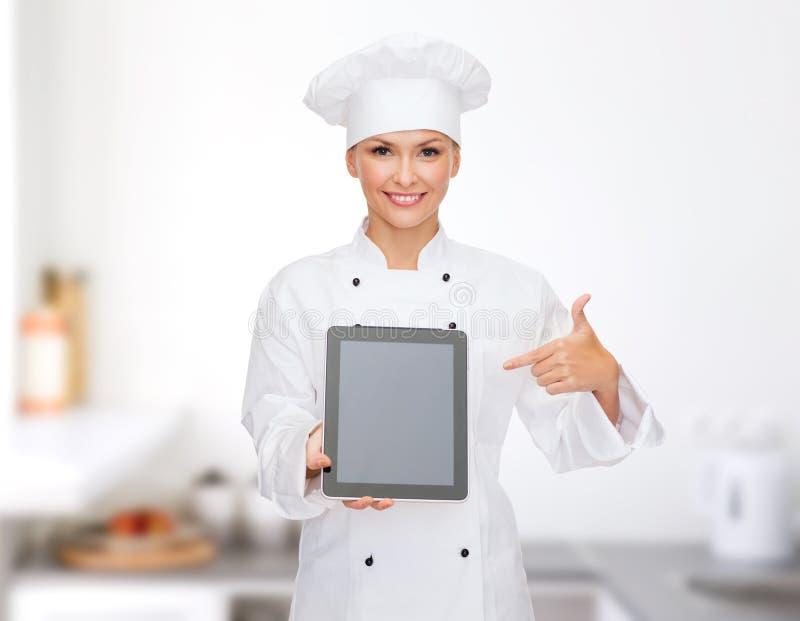 Glimlachende vrouwelijke chef-kok met het lege scherm van tabletpc royalty-vrije stock fotografie