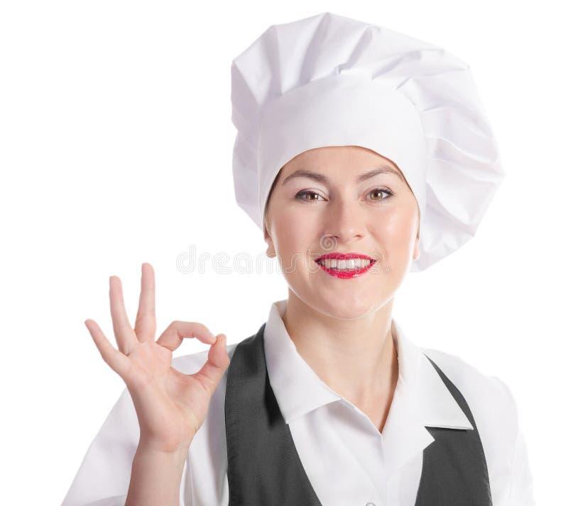 Glimlachende vrouwelijke die chef-kok op een witte achtergrond wordt geïsoleerd stock foto's