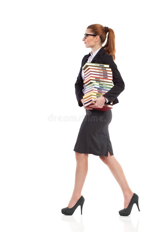 Download Glimlachende Vrouwen Dragende Boeken Stock Foto - Afbeelding bestaande uit hoog, volwassen: 39102874