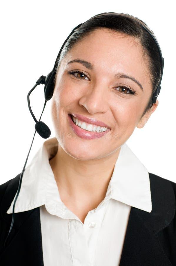Glimlachende vrouwenexploitant met hoofdtelefoon stock afbeeldingen