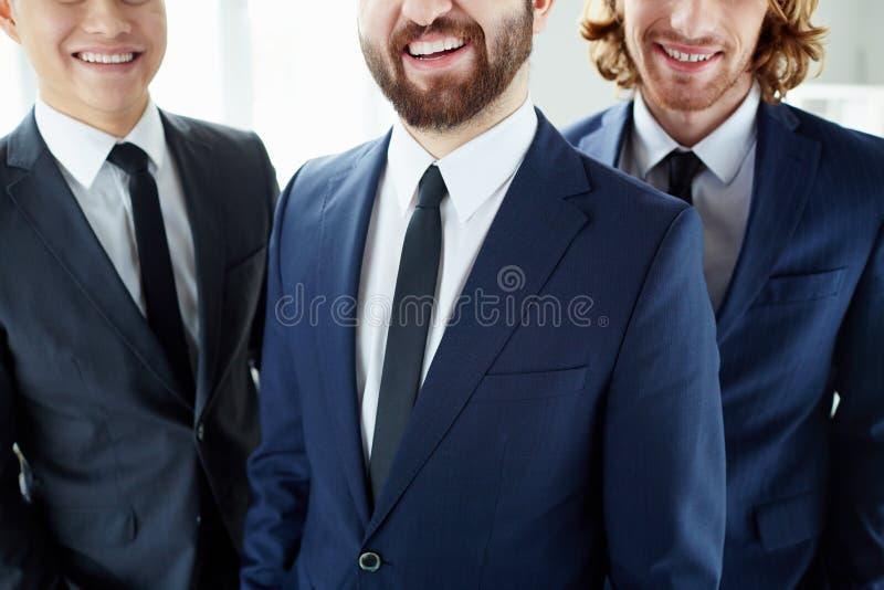 Glimlachende Zakenlieden stock fotografie