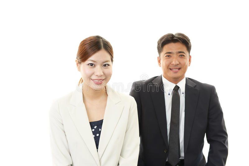 Glimlachende zakenman en onderneemsters stock fotografie