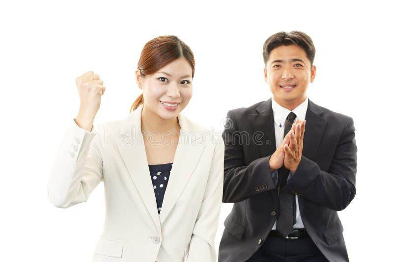 Glimlachende zakenman en onderneemsters royalty-vrije stock foto's