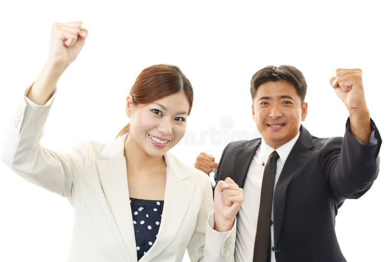 Glimlachende zakenman en onderneemsters royalty-vrije stock foto