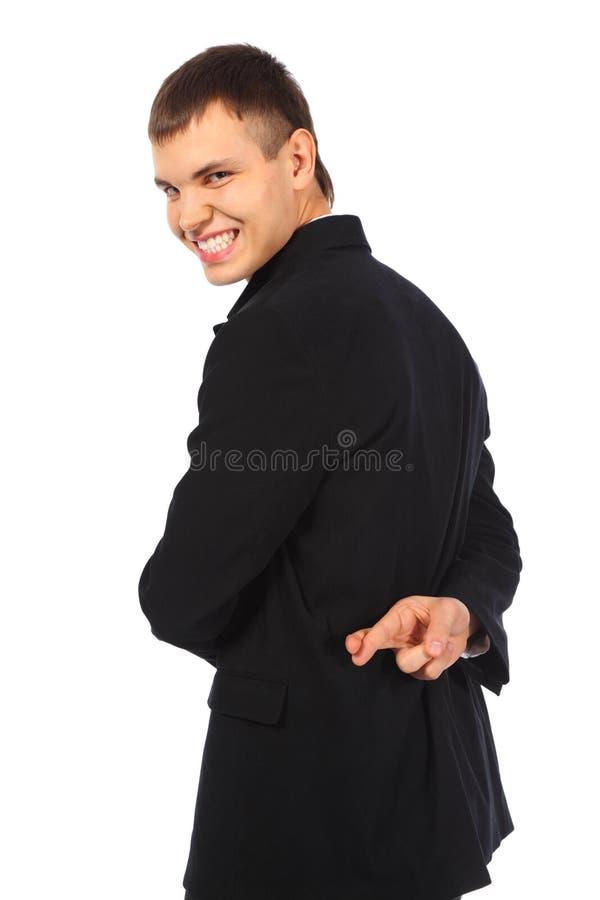 Glimlachende zakenman met gekruiste vingers royalty-vrije stock afbeeldingen