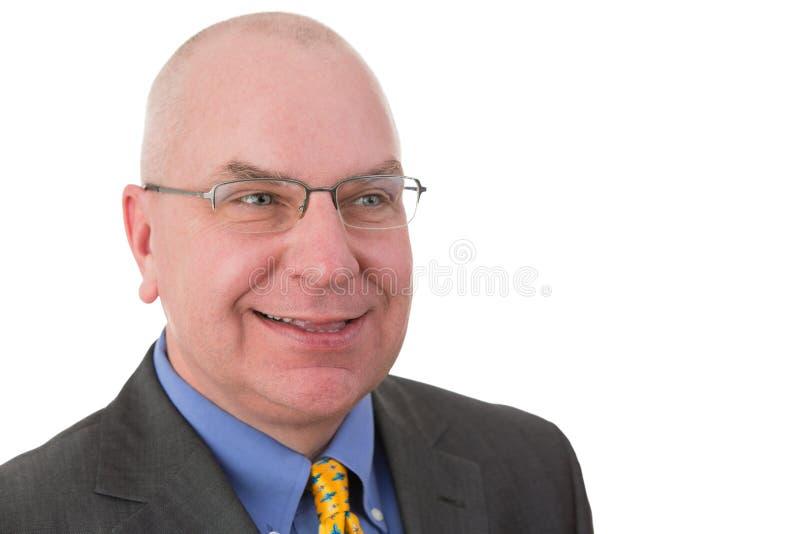 Glimlachende zelfgenoegzame zakenman stock afbeeldingen