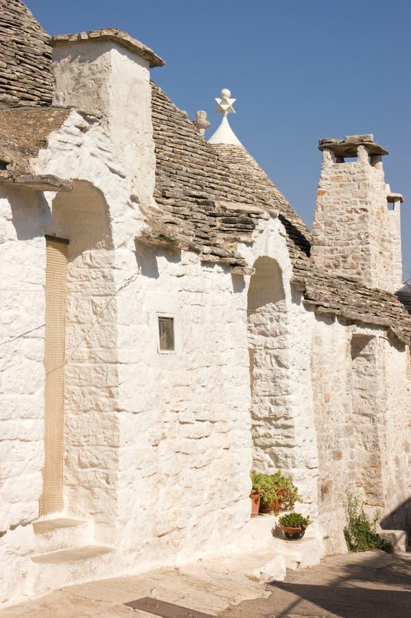 Glimpse of Alberobello stock images
