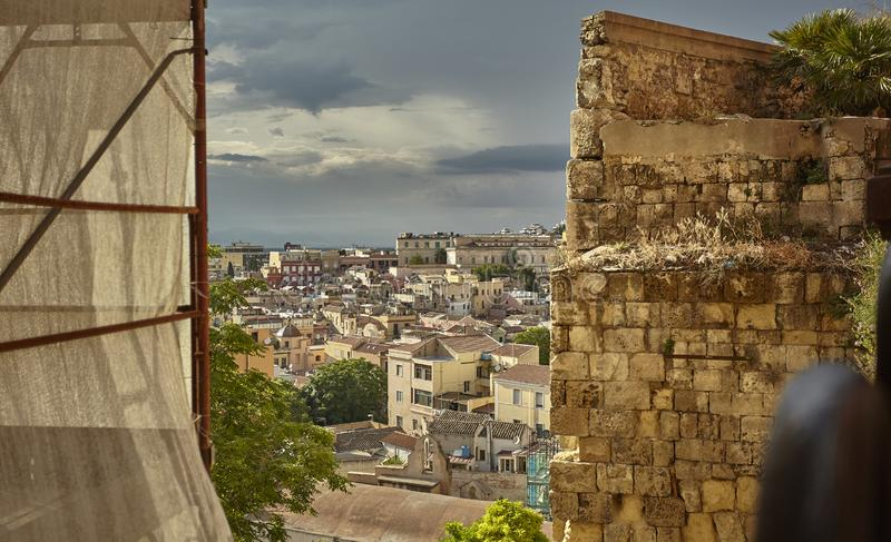 Glimpse of Cagliari. Glimpse filtered by a decaying wall of the city of Cagliari stock photography