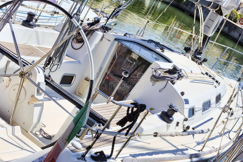 A glimpse of a fully equipped sailboat moored at the port royalty free stock photography