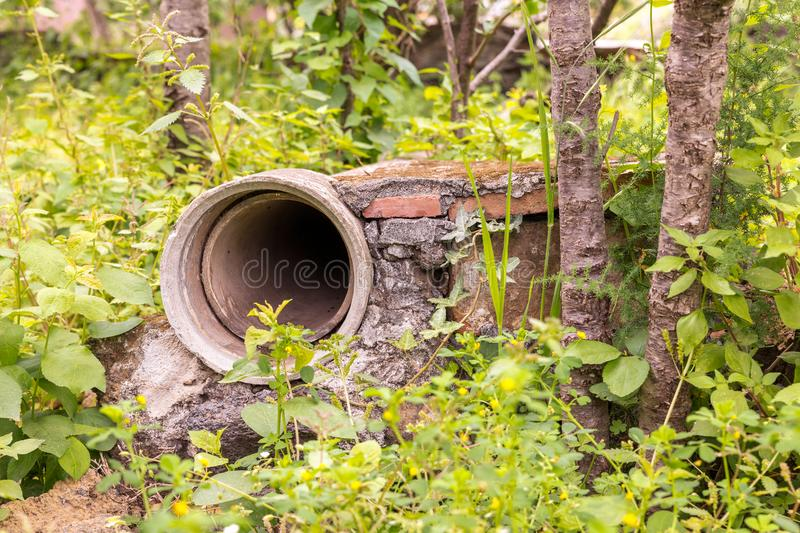Glimpse of the green spring. Countryside, detail of an irrigation pipe stock image