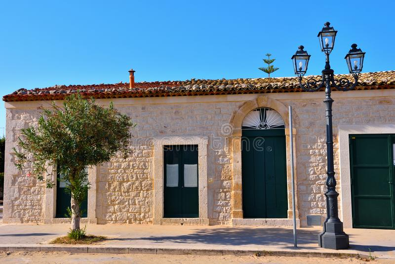 Glimpse of historic building in donnalucata. Ragusa Sicily Italy royalty free stock image