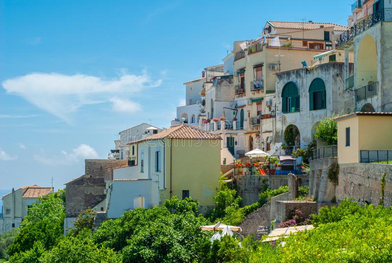 Glimpse of houses perched on a hill, with blue sky as a background. Taken in the summer season stock photography