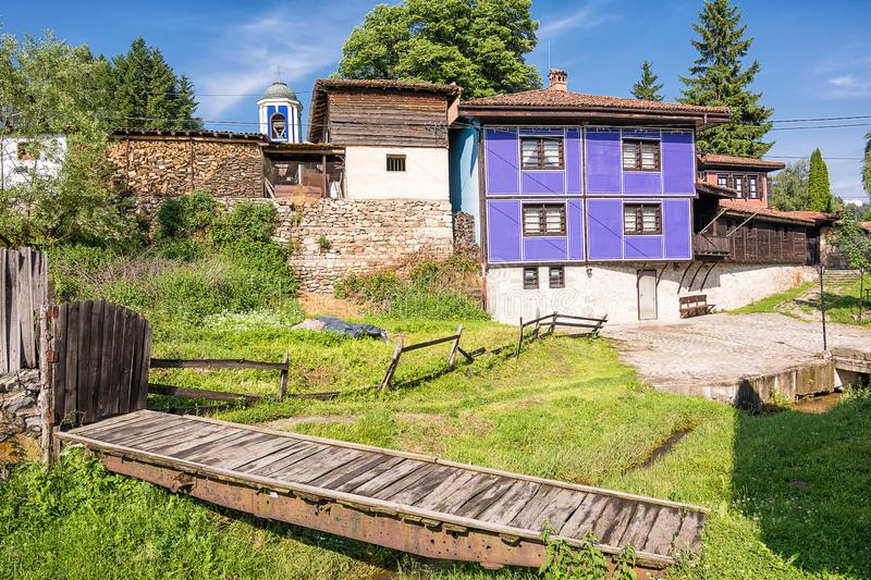 Glimpse of houses in and wooden bridge in the picturesque village of koprivshtitsa in Bulgaria. Glimpse of houses in and wooden bridge in the picturesque village stock images
