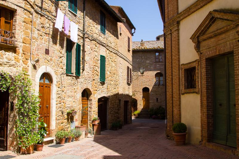Glimpse of a medieval Tuscan village, Italy. Italian rural landscape bricks cityscape daylight doors nobody old square summer toscana town townscape tuscany royalty free stock photography