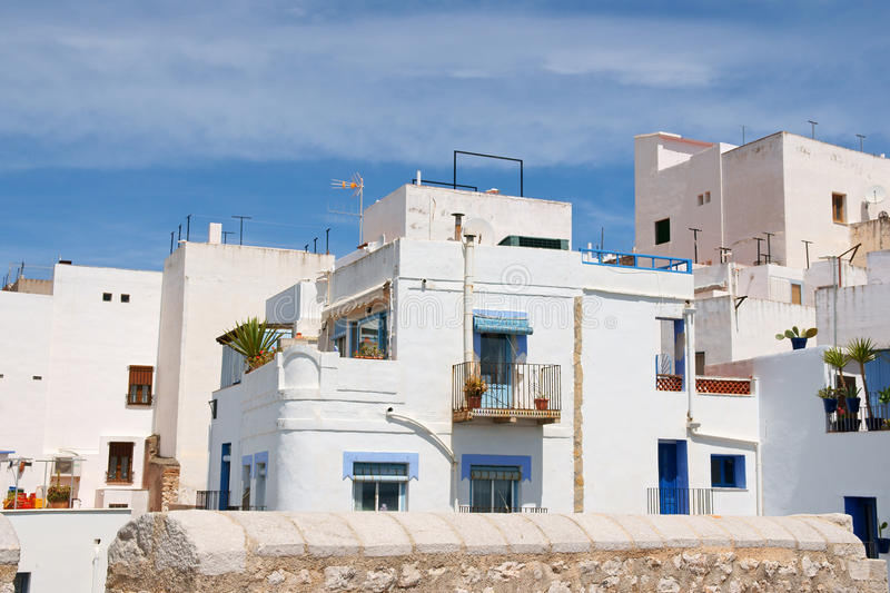 Glimpse of Peniscola, Spain. Glimpse of Peniscola with its white and blue houses and flat roofs. Valencian Autonomous Community, Spain stock images