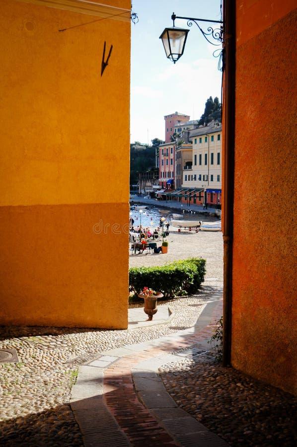 Glimpse of portofino harbor in genoa liguria. Small lane leading to portofino harbor in genoa liguria royalty free stock image