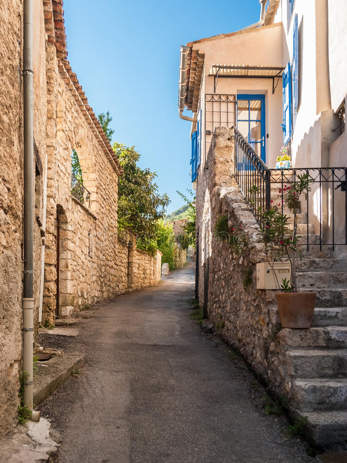 Glimpse of a street at Moustiers-Sainte-Marie, small town in Provence France royalty free stock images