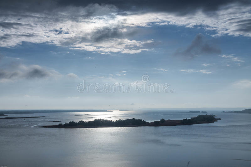 A glimpse of the sun through the clouds. A ray of sun over the river. Landscapes. royalty free stock image