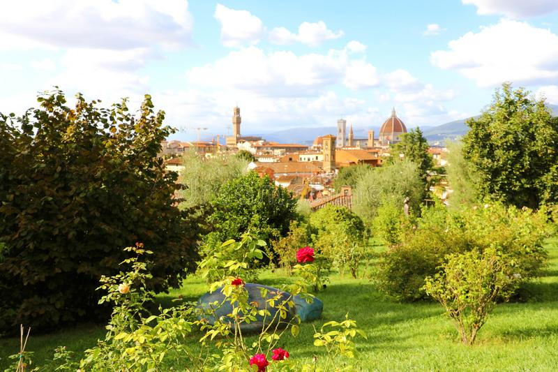 Glimpse view of Florence cityscape from park. Panoramic view of the city of Florence with Palazzo Vecchio palace and Cathedral of. Santa Maria del Fiore Duomo royalty free stock photos