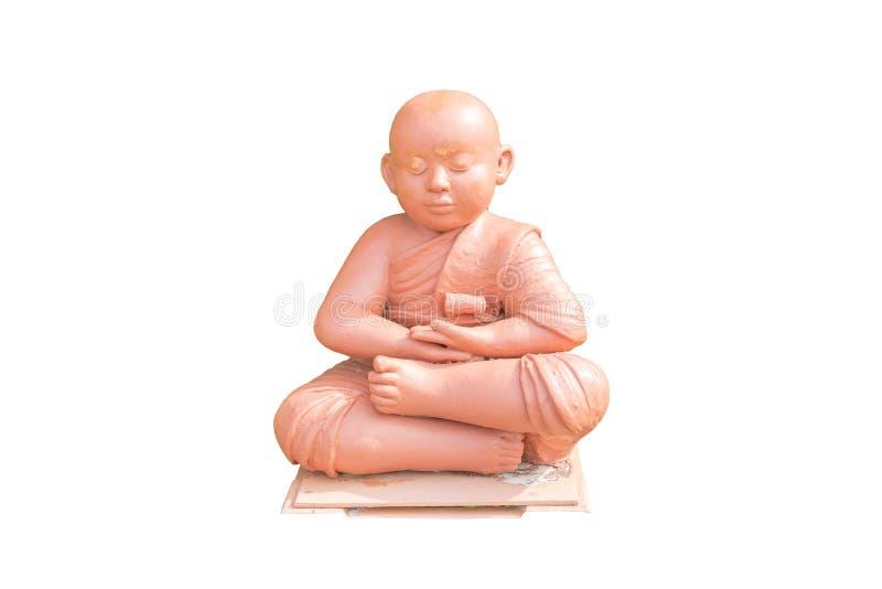 Gliniana lala Buddyjski nowicjusza mienia obsiadanie dla medytaci obrazy stock