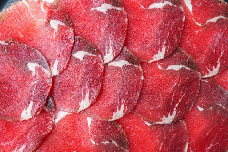 Glissez la viande crue photo stock