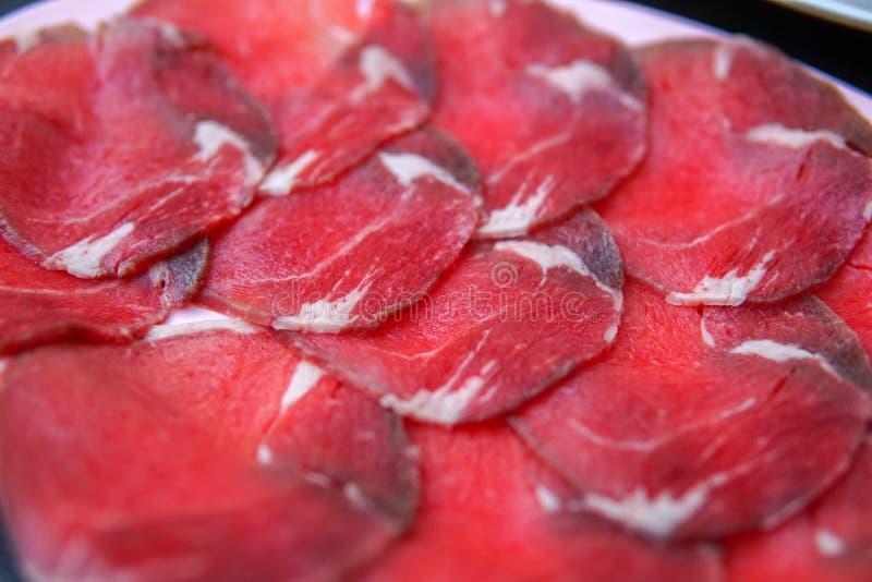 Glissez la viande crue photos stock